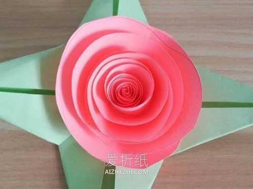 简单手工制作纸玫瑰花的方法图解,把粉红色的彩纸剪成类似蚊香一样